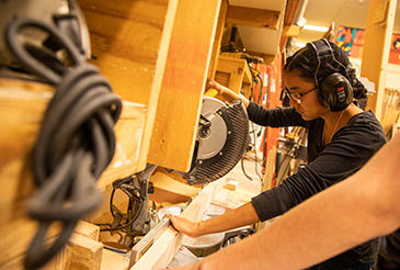 student working in the scene shop